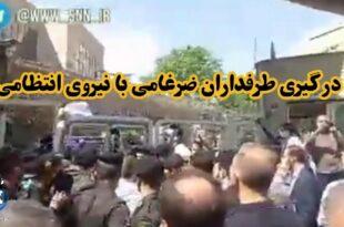 طرفداران ضرغامی در هنگام ورود او به وزارت کشور برای ثبت نام در انتخابات ریاست جمهوری با نیروی انتظامی درگیر شدند